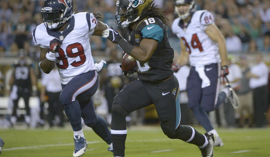FILE - In this Dec. 5, 2013, file photo, Jacksonville Jaguars wide receiver Ace Sanders (18) returns a punt for yardage as he is chased by Houston Texans tight end Jake Byrne (89) and Ryan Griffin (84) during the first half of an NFL football game in Jacksonville, Fla. Sanders returns Sunday, Oct. 5, 2014, after missing the first four games of the season for violating the league's substance-abuse policy.(AP Photo/Phelan M. Ebenhack, File)