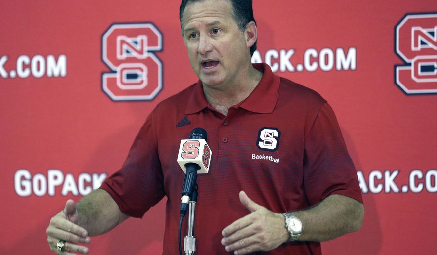 North Carolina State coach Mark Gottfried makes a statement during the team's NCAA college basketball media day in Raleigh, N.C., Wednesday, Oct. 1, 2014. (AP Photo/Gerry Broome)
