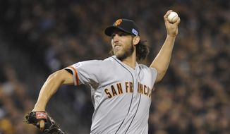 San Francisco Giants starting pitcher Madison Bumgarner throws against the Pittsburgh Pirates in the first inning of a wild-card playoff baseball game Wednesday, Oct. 1, 2014, in Pittsburgh. (AP Photo/Don Wright)