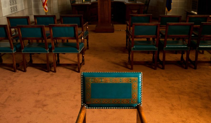 In this Aug. 28, 2014 photo shows chairs in the governor's hearing room at the State Capitol in Lincoln, Neb.  The State Capitol administrator is defending the cost of restoring 46 antique statehouse chairs at a cost of nearly $2,000 each. (AP Photo/The Omaha World-Herald, Ryan Soderlin) MAGS OUT TV OUT