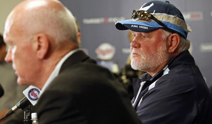 Former Minnesota Twins manager Ron Gardenhire, right, listens as Twins general manager Terry Ryan answers a question at a baseball news conference officially announcing the firing of Gardenhire, Monday, Sept. 29, 2014, in Minneapolis. (AP Photo/Jim Mone)