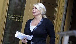 In this Aug. 6, 2013 file photo, Kristin Davis leaves Manhattan federal court in New York. Davis, a former madam who ran against former Gov. Eliot Spitzer in the race for New York City comptroller, peddled hundreds of powerful painkillers and other prescription pills in exchange for Ecstasy and cash from a drug dealer wearing a wire, according to federal authorities. Davis was sentenced to two years in prison, Wednesday, Oct. 1, 2014. (AP Photo/Louis Lanzano, File)