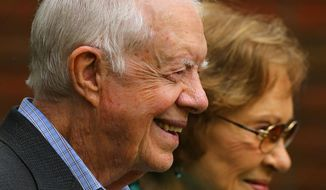 Former President Jimmy Carter and former first lady Rosalynn Carter greet visitors outside the Maranatha Baptist Church after service on Sunday, Sept. 28, 2014, in Plains, Ga. Carter is celebrating his 90th birthday in Atlanta on Wednesday, Oct. 1, 2014. Carter is the second-oldest of the five living U.S. presidents.  (AP Photo/Atlanta Journal-Constitution, Curtis Compton)  MARIETTA DAILY OUT; GWINNETT DAILY POST OUT; LOCAL TELEVISION OUT; WXIA-TV OUT; WGCL-TV OUT