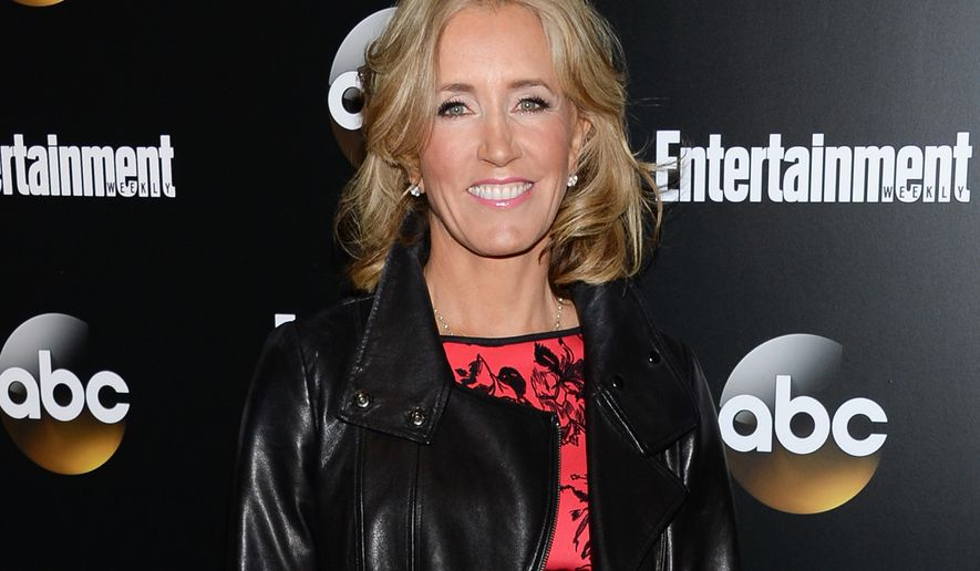 """FILE - In this May 13, 2014 file photo, actress Felicity Huffman attends the Entertainment Weekly and ABC network upfront party in New York. Huffman plays a mother in the upcoming drama """"American Crime,"""" premiering on ABC in March 2015. (Photo by Evan Agostini/Invision/AP, File)"""