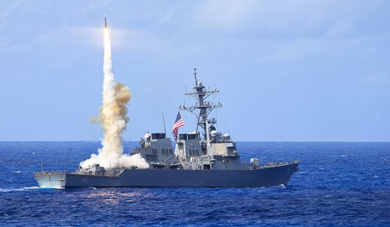 The Arleigh Burke-class guided-missile destroyer USS Curtis Wilbur (DDG 54) fires a Standard Missile 2 (SM-2) during a missile firing exercise. (U.S. Navy photo)