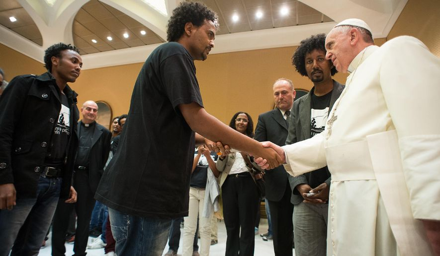In this picture provided by the Vatican newspaper L'Osservatore Romano, Pope Francis meets relatives of victims and survivors of the Lampedusa deadly migrant shipwreck during a private audience at the Vatican, Wednesday Oct. 1, 2014.  Around 370 people, most of them Eritrean and Syrian asylum-seekers, drowned on Oct. 3, 2013 when their smugglers' boat capsized off the island of Lampedusa.  Pope Francis has called for the Europe to open its doors to refugees as he marked the anniversary of the deadly shipwreck. (AP Photo/L'Osservatore Romano, ho)