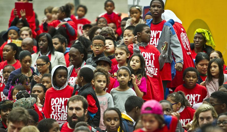 "Youngsters listen to speakers during a rally at Foley Square organized by Families for Excellent Schools (FES), Thursday Oct. 2, 201. in New York. Families for Excellent Schools, a grassroots movement of public school families, is calling ""for bold, urgent change to ensure no child in New York City is forced to attend a failing school, according to a press release statement.  (AP Photo/Bebeto Matthews)"