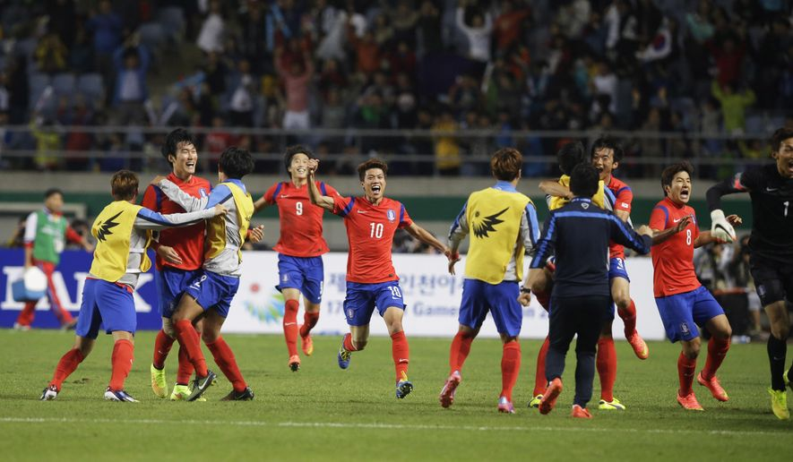 South Korean players celebrate their winning goal during their men's soccer final match against North Korea at the 17th Asian Games in Incheon, South Korea, Thursday, Oct. 2, 2014. (AP Photo/Dita Alangkara)