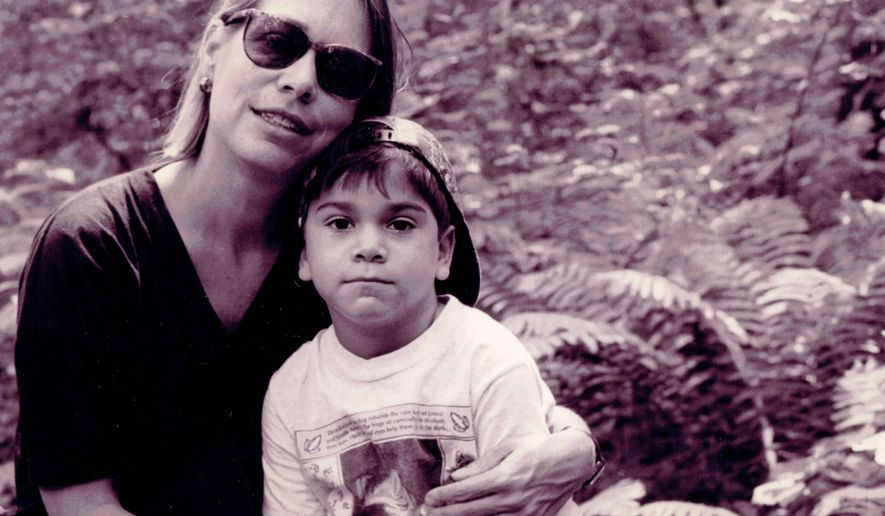 In this 1990s-era photo toned by the source, human rights activist Cathy Potler poses with her son Natan Vega Potler, in upstate New York. Potler, who investigated human rights abuses in South and Central America in the 1970s and '80s, as well as in jails and prisons throughout New York state, died of non-small cell lung cancer in the early hours of Sept. 21, 2014. She was 61. (AP Photo/Martin Vega)