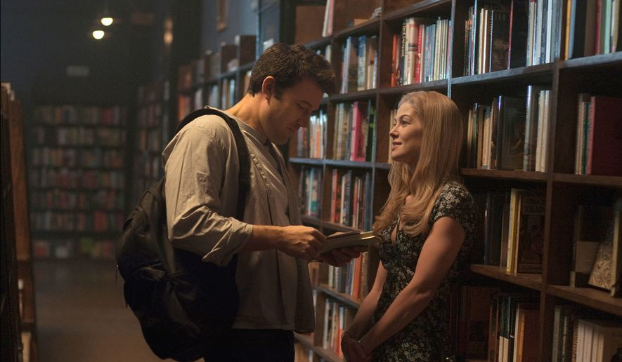 """Gone Girl,"" starring Ben Affleck (left) as Nick Dunne and Rosamund Pike as his wife Amy, isn't a murder mystery so much as a marriage mystery with their lives under the microscope. (20th Century Fox Via Associated Press)"