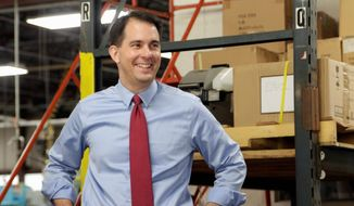 incumbent: Republican Wisconsin Gov. Scott Walker is running on his record of bringing business to the state. (Associated Press)