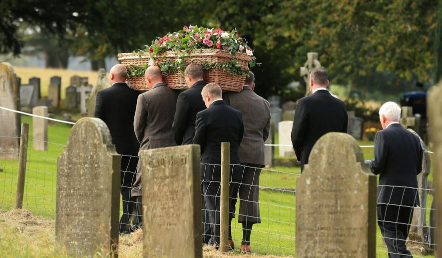 The coffin of Deborah, the Dowager Duchess of Devonshire is carried from St Peter's Church following her funeral service, on the Chatsworth estate, England, Thursday Oct. 2, 2014. The last of the famous Mitford sisters, the Dowager Duchess of Devonshire, died at the age of 94. (AP Photo/PA, Lynne Cameron) UNITED KINGDOM OUT  NO SALES  NO ARCHIVE