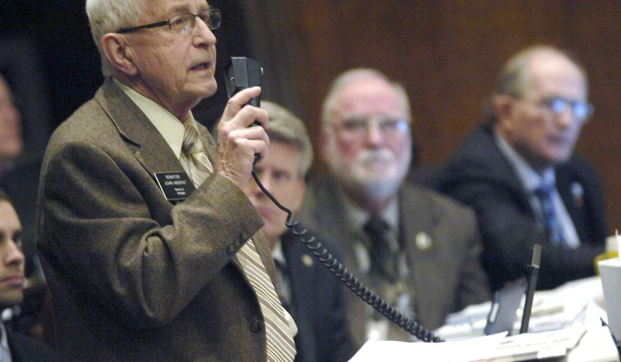 This Feb. 26, 2013 photo, Sen. John Andrist, R-Crosby, speaks against an amendment in Bismarck, N.D.  Andrist says he's retiring due to declining health. Andrist says he plans to resign his seat effective Nov. 30, 2014 and move to an assisted living center in Fargo.   The Republican from Crosby was first elected to the Senate in 1992, serving District 2 in the northwestern corner of the state. He has been known for being an advocate of rural North Dakota. (AP/Bismarck Tribune, Mike McCleary)