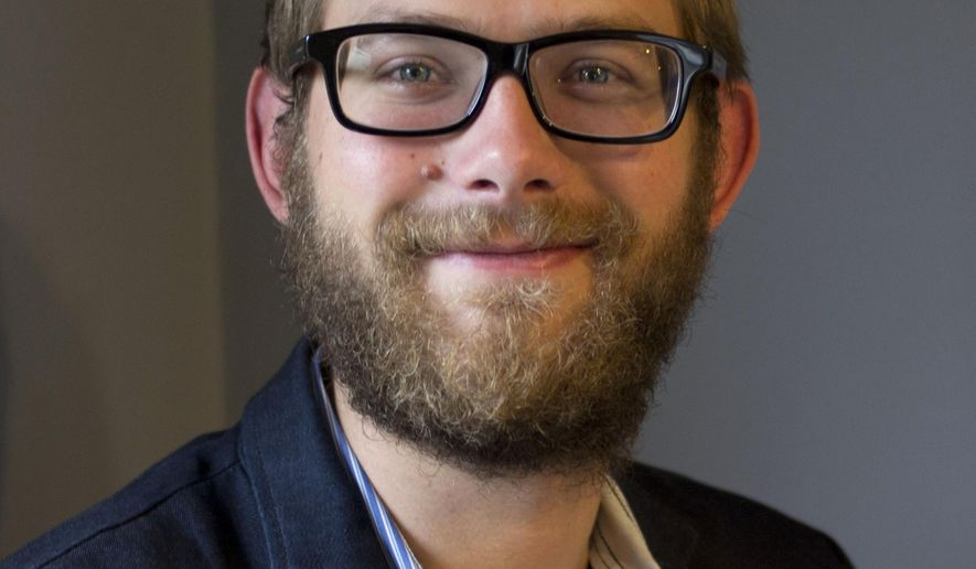 In this Oct. 2, 2014 photo is James Nord who was  named Thursday, Oct. 2, as The Associated Press correspondent in Pierre, South Dakota. Nord, 25, is a native of Shorewood, Minn., and a graduate of the University of Minnesota. (AP Photo/James Nord)