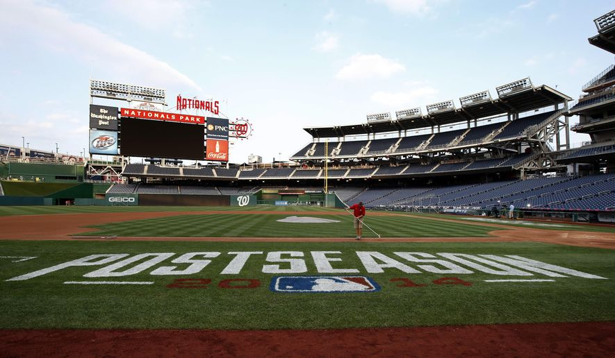 A member of the Washington Nationals grounds crew works the field after MLB baseball workouts at Nationals Park, Thursday, Oct. 2, 2014, in Washington. The Washington Nationals play the San Francisco Giants in the National League Division Series starting Friday. (AP Photo/Alex Brandon)