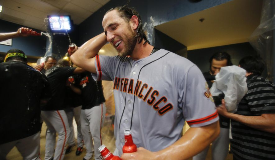 San Francisco Giants starting pitcher Madison Bumgarner celebrates after pitching the Giants to an 8-0 win over the Pittsburgh Pirates in the National League wild-card baseball playoff game in Pittsburgh on Wednesday, Oct. 1, 2014. (AP Photo/Gene J. Puskar)