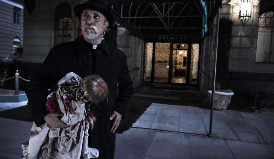 "This photo released by Warner Bros. Pictures shows, Tony Amendola as Father Perez with the Annabelle doll in New Line Cinema's supernatural thriller, ""Annabelle,"" a Warner Bros. Pictures release. The movie opens Friday, Oct. 3, 2014.  (AP Photo/Warner Bros. Pictures, Gregory Smith)"