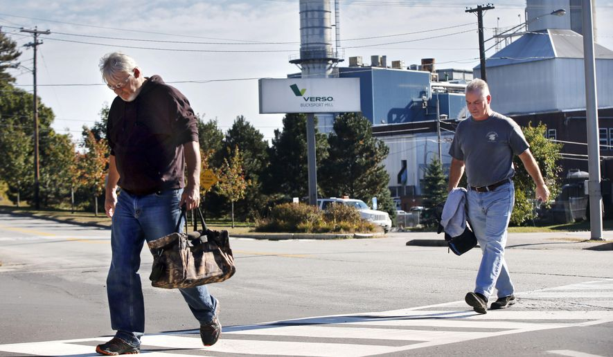 Workers leave the Verso paper mill Thursday, Oct. 2, 2014 in Bucksport, Maine. While stunned workers say they're scrambling for new work, local residents fear a huge tax increase when mill closes on Dec. 1. The mill employs 570 people and accounts for more than 40 percent of Bucksport's budget. (AP Photo/Robert F. Bukaty)