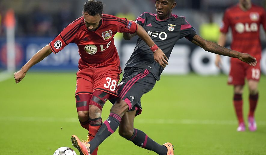 CORRECTS MONTH - Leverkusen's Karim Bellarabi, left and Benfica's Anderson Talisca, right, challenge for the ball during the Champions League group C soccer match between Bayer 04 Leverkusen and SL Benfica at the BayArena stadium in Leverkusen, Germany, Wednesday, Oct. 1, 2014. (AP Photo/Martin Meissner)