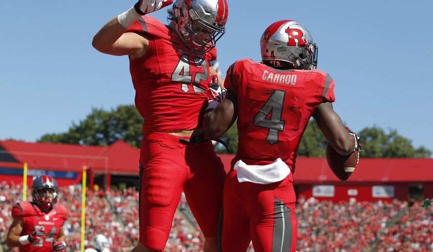 Rutgers tight end Nick Arcidiacono (42) celebrates with wide receiver Leonte Carroo (4) after Carroo's touchdown catch against Tulane during the first half of an NCAA college football game Saturday, Sept. 27, 2014, in Piscataway, N.J. Rutgers defeated Tulane 31-6. (AP Photo/Rich Schultz)