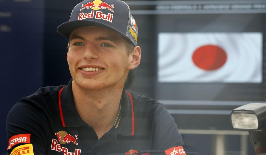 Netherlands' 17-year-old driver Max Verstappen smiles inside Toro Rosso's hospitality suite ahead of Sunday's Japanese Formula One Grand Prix at the Suzuka Circuit in Suzuka, central Japan, Thursday, Oct. 2, 2014. When the 2015 F1 championship starts in Australia in March, Verstappen will become the youngest ever Formula One driver. (AP Photo/Shizuo Kambayashi)