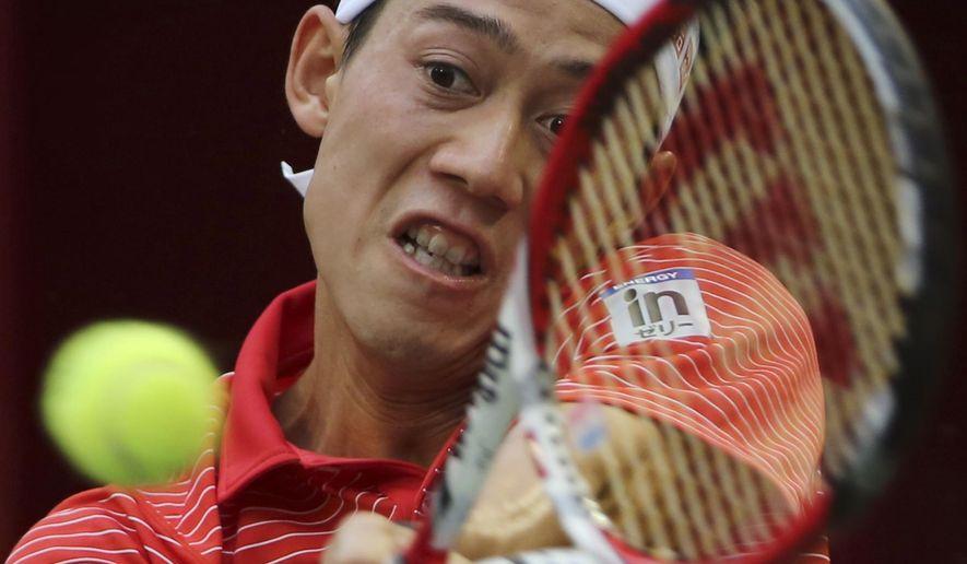 Kei Nishikori of Japan returns a shot against Donald Young of the United States during their second round match of Japan Open Tennis Championships in Tokyo, Thursday, Oct. 2, 2014. (AP Photo/Koji Sasahara)