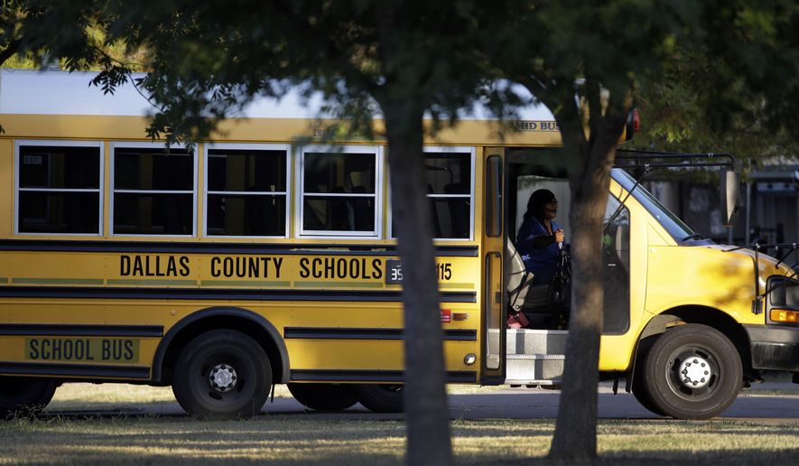 A Dallas Independent School District bus departs L.L. Hotchkiss Elementary school after dropping off students, Thursday, Oct. 2, 2014, in Dallas. Hotchkiss has been identified by the Dallas Independent School District as one of the schools where one or more of the students attend that came in contact with the man diagnosed with having the Ebola virus. (AP Photo/Tony Gutierrez)