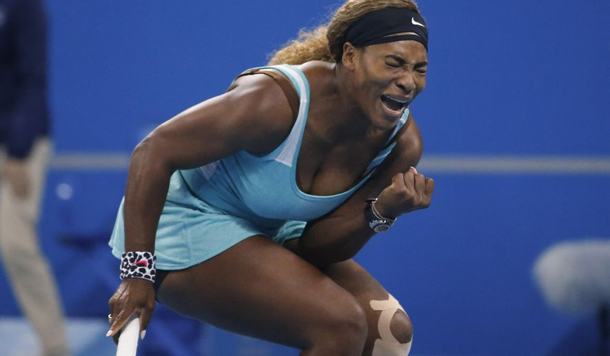Serena Williams of the U.S celebrates after she scored a point during match against Lucie Safarova of the Czech Republic during the China Open tennis tournament at the National Tennis Stadium in Beijing, China, Thursday, Oct. 2, 2014. (AP Photo/Vincent Thian)