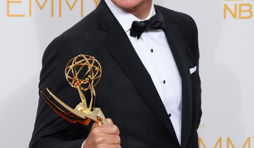 """FILE - In this Aug. 25, 2014 file photo, Stephen Colbert poses with the award for Outstanding Variety Series in the press room at the 66th Annual Primetime Emmy Awards in Los Angeles. Colbert is mocking Bill O'Reilly's proposal that a 25,000-member mercenary force be armed and trained to fight the Islamic state. Colbert countered with his own """"army of expert double Ninja super soldiers with laser nunchucks,"""" imagined when he was in the fourth grade. (Photo by Jordan Strauss/Invision/AP, File)"""