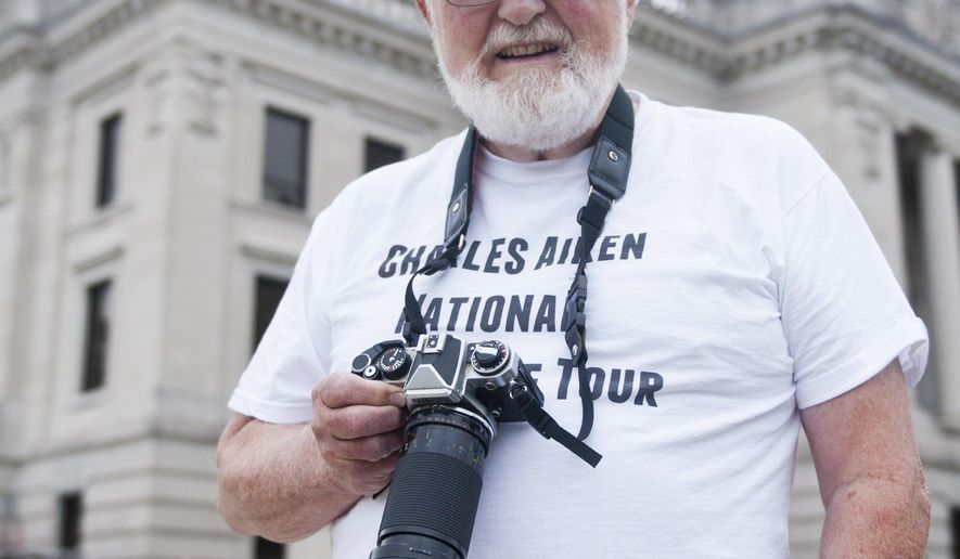 Charles Aiken poses with his camera at the Monroe County Courthouse in Bloomington, Ind., on Sept. 11. Aiken has photographed every courthouse in the U.S. and is planning to put his photographs on a web page.  (AP Photo/Bloomington Herald-Times, Matthew Hatcher)