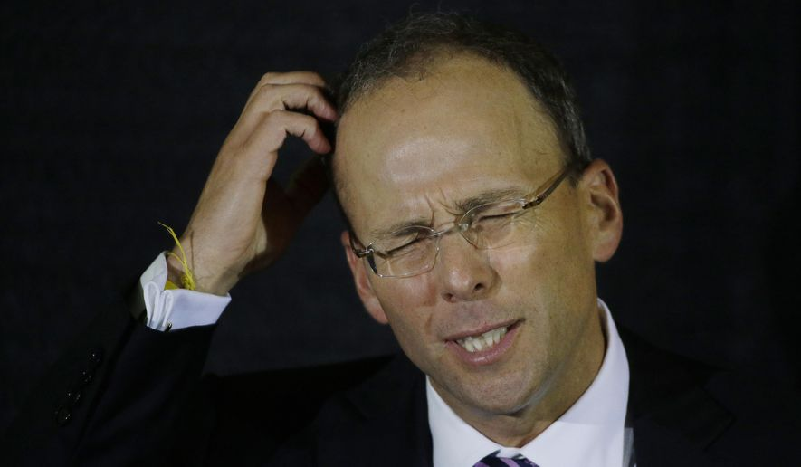 New England Patriots President Jonathan Kraft scratches his head as he thinks about his answer to a question during a talk about the business of the NFL during a Bloomberg Business of Sports Discussion at the State Room Thursday, Oct. 2, 2014 in Boston. (AP Photo/Stephan Savoia)