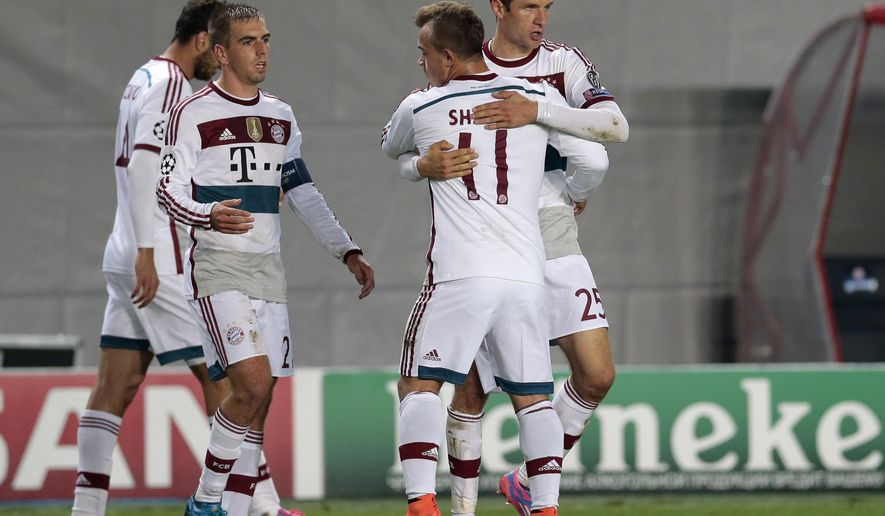 Bayern's Xherdan Shaqiri, 3rd left and Thomas Mueller, right, congratulate each other at the end of the Champions League Group E soccer match between CSKA Moscow and Bayern Munich at the Arena Khimki stadium in Moscow, Russia, Tuesday Sept. 30, 2014. Bayern won the match 1-0. (AP Photo/Ivan Sekretarev)