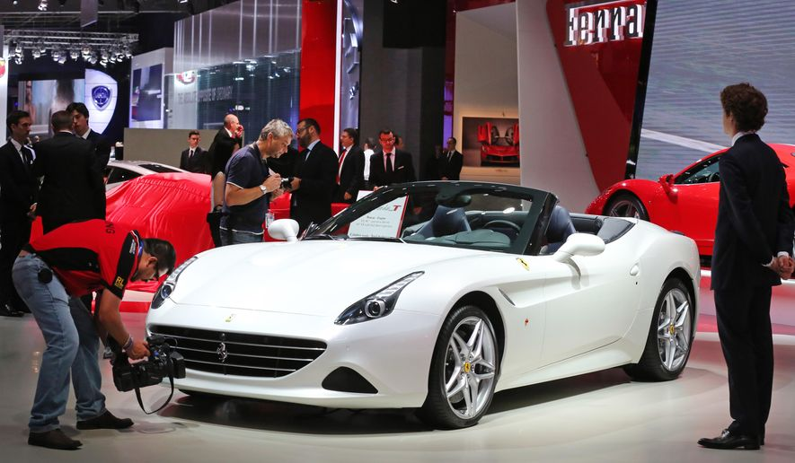 A Ferrari California T is presented at the Paris Motor Show, in Paris, Thursday Oct. 2, 2014. The Paris Motor Show will open its doors to the public on Saturday Oct. 4, until Oct. 19.  European carmakers are hoping to impress with new models at this week's Paris Motor Show and prove they have come out stronger from years of economic trouble and cost-cutting. (AP Photo/Remy de la Mauviniere)