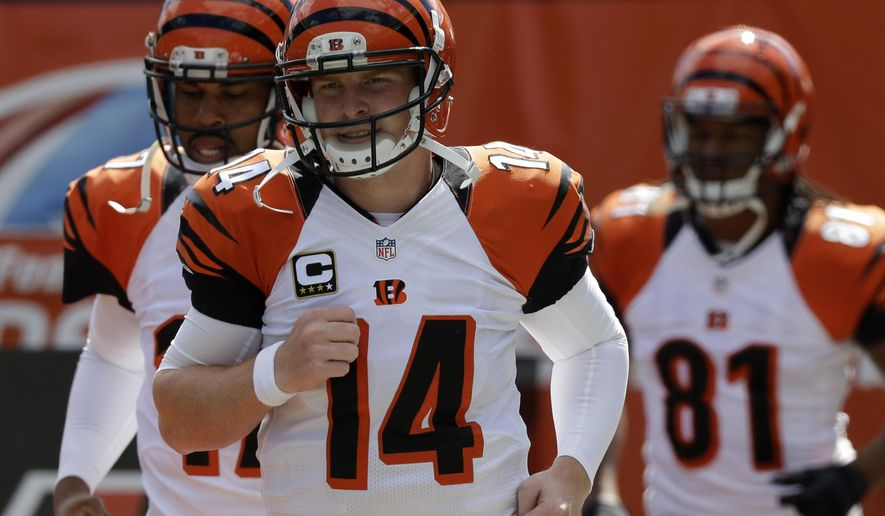 ADVANCE FOR WEEKEND EDITIONS, OCT. 4-5 - FILE - In this Sept. 14, 2014, file photo, Cincinnati Bengals quarterback Andy Dalton (14) warms up prior to an NFL preseason football game against the Atlanta Falcons in Cincinnati. The unbeaten Bengals (3-0) play the New England Patriots (2-2) on Sunday, Oct. 5. (AP Photo/Al Behrman, File)