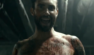Maroon 5's Adam Levine is under fire for a new music video released Monday that critics claim glorifies stalking and rape. (Vevo)