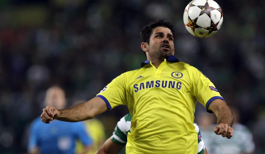 Chelsea's Diego Costa goes for the ball during a Champions League, Group G soccer match between Sporting and Chelsea, in Lisbon, Tuesday, Sept. 30, 2014. (AP Photo/Francisco Seco)