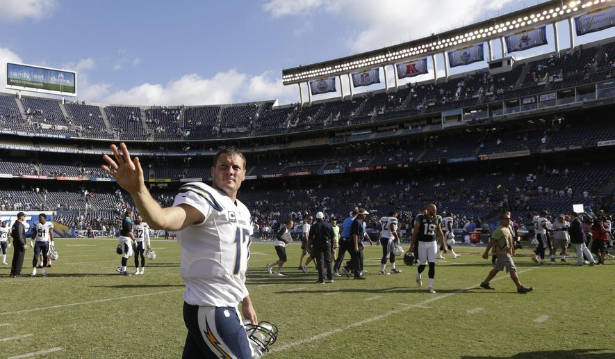 San Diego Chargers quarterback Philip Rivers waves as he leaves the field after the Chargers defeated the Jacksonville Jaguars in an NFL football game Sunday, Sept. 28, 2014, in San Diego. The Chargers won, 33-14. (AP Photo/Gregory Bull)
