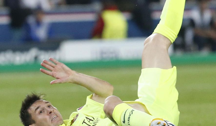 Barcelona's Lionel Messi falls after being tackled during the Champions League Group F soccer match between Paris Saint German and Barcelona at Parc des Princes stadium in Paris, France, Tuesday, Sept. 30, 2014. (AP Photo/Michel Euler)