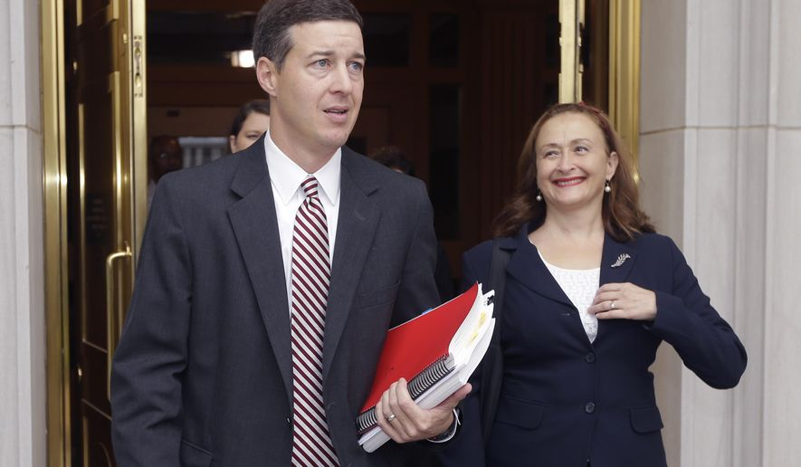 Attorney Jeff Priebe, left, and Rita Sklar, executive director of American Civil Liberties Union Arkansas, leave the Arkansas Supreme Court in Little Rock, Ark., Thursday, Oct. 2, 2014. Justices heard oral arguments Thursday in the challenge to the voter ID law enacted last year by the Arkansas Legislature. (AP Photo/Danny Johnston)