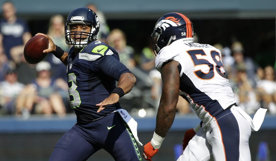 Seattle Seahawks quarterback Russell Wilson passes under pressure from Denver Broncos outside linebacker Von Miller (58) during the first half of an NFL football game, Sunday, Sept. 21, 2014, in Seattle. (AP Photo/Elaine Thompson)