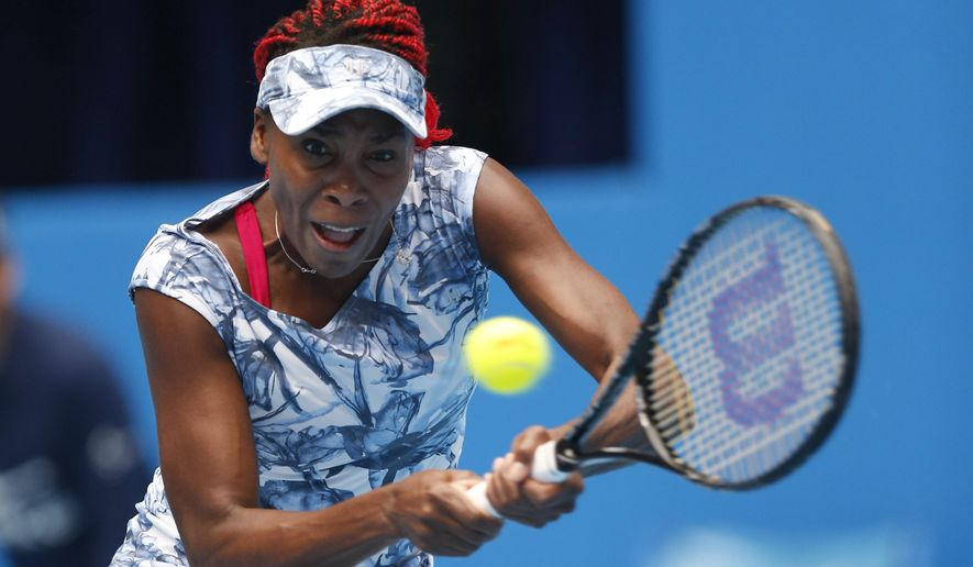 Venus Williams of the United States, returns a shot against Heather Watson of Britain during their first round match of China Open tennis tournament in Beijing, China, Sunday, Sept. 28, 2014. (AP Photo/Vincent Thian)