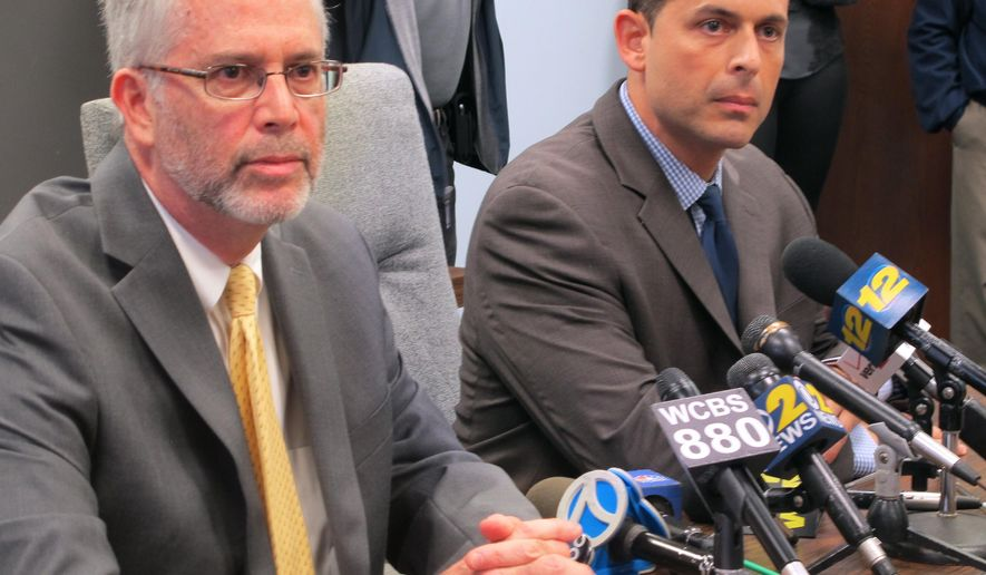 """Shoreham-Wading River Superintendent of Schools Dr. Steven Cohen, left, and high school principal Dan Holtzman, right, speak at a news conference, Thursday, Oct. 2, 2014, in Wading River, N.Y., following the death on Wednesday of Shoreham Wading-River football player Tom Cutinella. Cohen called the death of a 16-year-old following an on-field collision a """"freak accident."""" The medical examiner, police and school officials are investigating. (AP Photo/Frank Eltman)"""