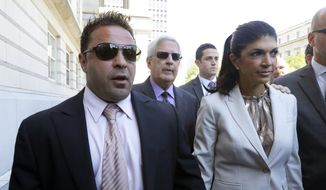 "FILE - In this July 30, 2013 file photo, ""The Real Housewives of New Jersey"" stars Giuseppe ""Joe"" Giudice, 43, left, and his wife, Teresa Giudice, 41, of Montville Township, N.J., walk out of Martin Luther King, Jr. Courthouse after an appearance in Newark, N.J. Teresa and Giuseppe ""Joe"" Giudice are scheduled to be sentenced Thursday Oct. 2, 2014 on conspiracy and bankruptcy fraud charges in federal court in Newark.  (AP Photo/Julio Cortez, File)"