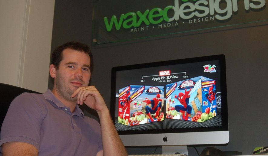 "Paul Tomlinson, founder and owner of Waxed Designs LLC, created the graphics and slogan for the ""Snack Like a Super Hero"" campaign for Sage Fruit. He was aided by two other local companies, Team Image Marketing and Sumter Packaging Corporation, in bringing the displays to life. (AP Photo/The Item, Jade Reynolds)"