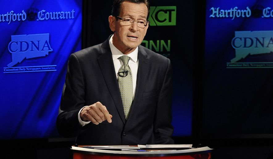 Incumbent Democrat Gov. Dannel P. Malloy, speaks during a live televised debate with Republican candidate for governor Tom Foley at the University of Connecticut, Thursday, Oct. 2, 2014, in Storrs, Conn. (AP Photo/Jessica Hill)