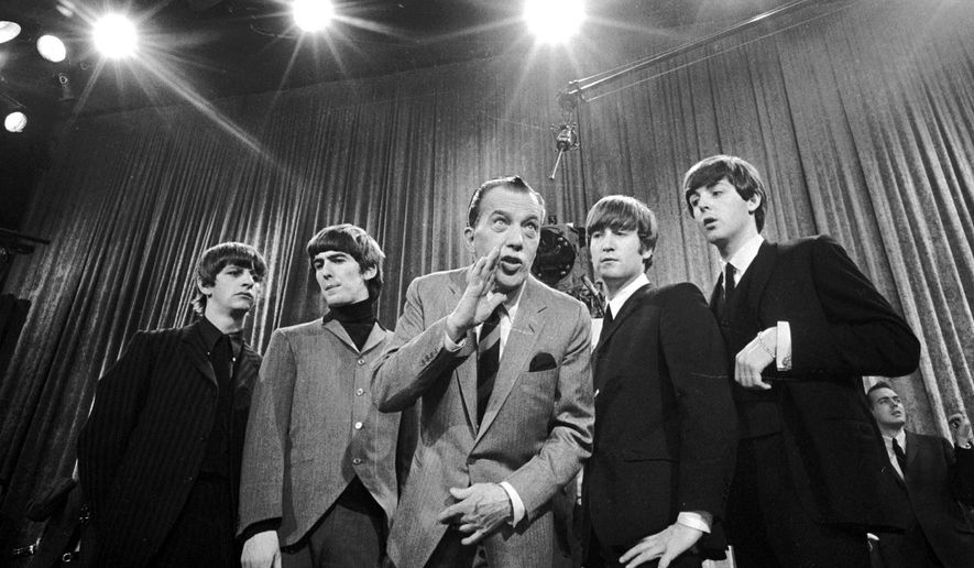 """FILE - In this Feb. 8, 1964 file photo, Ed Sullivan, center, stands with The Beatles, from left, Ringo Starr, George Harrison, John Lennon and Paul McCartney, during a rehearsal for the British group's first American appearance on """"The Ed Sullivan Show,"""" in New York. A small, 18-inch solid bronze statue of the legendary television variety show host, Sullivan, has been recovered by Los Angeles police Thursday, Oct. 2, 2014. The statue was taken Sunday from atop a pedestal in an outdoor exhibit at the Academy of Television Arts & Sciences Hall of Fame Plaza in North Hollywood. (AP Photo, File)"""