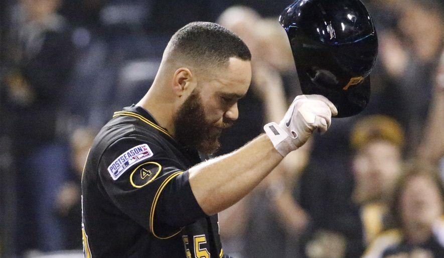 Pittsburgh Pirates catcher Russell Martin tips his helmet to the cheering fans after his last at-bat against the San Francisco Giants, in the ninth inning of the NL wild-card playoff baseball game Wednesday, Oct. 1, 2014, in Pittsburgh. The Giants won 8-0, advancing to the division series. (AP Photo/Gene J. Puskar)