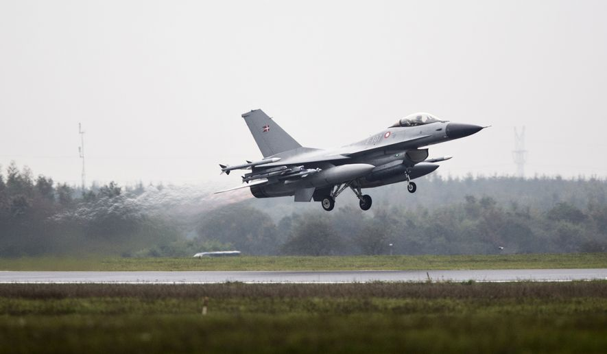 One of the seven Danish F-16 fighter jets takes off from military airport Flyvestation Skrydstrup in Jutland, Denmark, Thursday, Oct. 2, 2014. Danish lawmakers have confirmed the government's proposal to send seven F-16 fighter jets to join an international coalition to take part in airstrikes against the Islamic State extremist group. In a 94-9 vote with 76 absentees, lawmakers on Thursday sent four operational planes and three reserve jets along with 140 pilots and support staff for 12 months. The fighters will be based in Kuwait and will not deploy in Syria. (AP Photo/Janus Engel, POLFOTO)      DENMARK OUT
