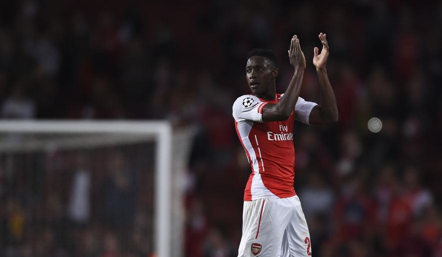 Arsenal's Danny Welbeck  claps his hands after the end of a Champions League Group D soccer match between Arsenal  and Galatasaray , at the Emirates Stadium in London, on Wednesday, Oct 1, 2014. Welbeck score a hat-trick and his team won 4-1.(AP Photo/ Tim Ireland)