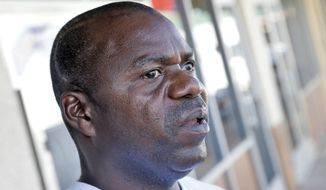 Wilfred Smallwood, who identified himself as a brother of Ebola patient Thomas Eric Duncan, speaks about his brother, Wednesday, Oct. 1, 2014, in Phoenix. Duncan has been kept in isolation at a hospital since Sunday. He was listed in serious but stable condition.  (AP Photo/Matt York)